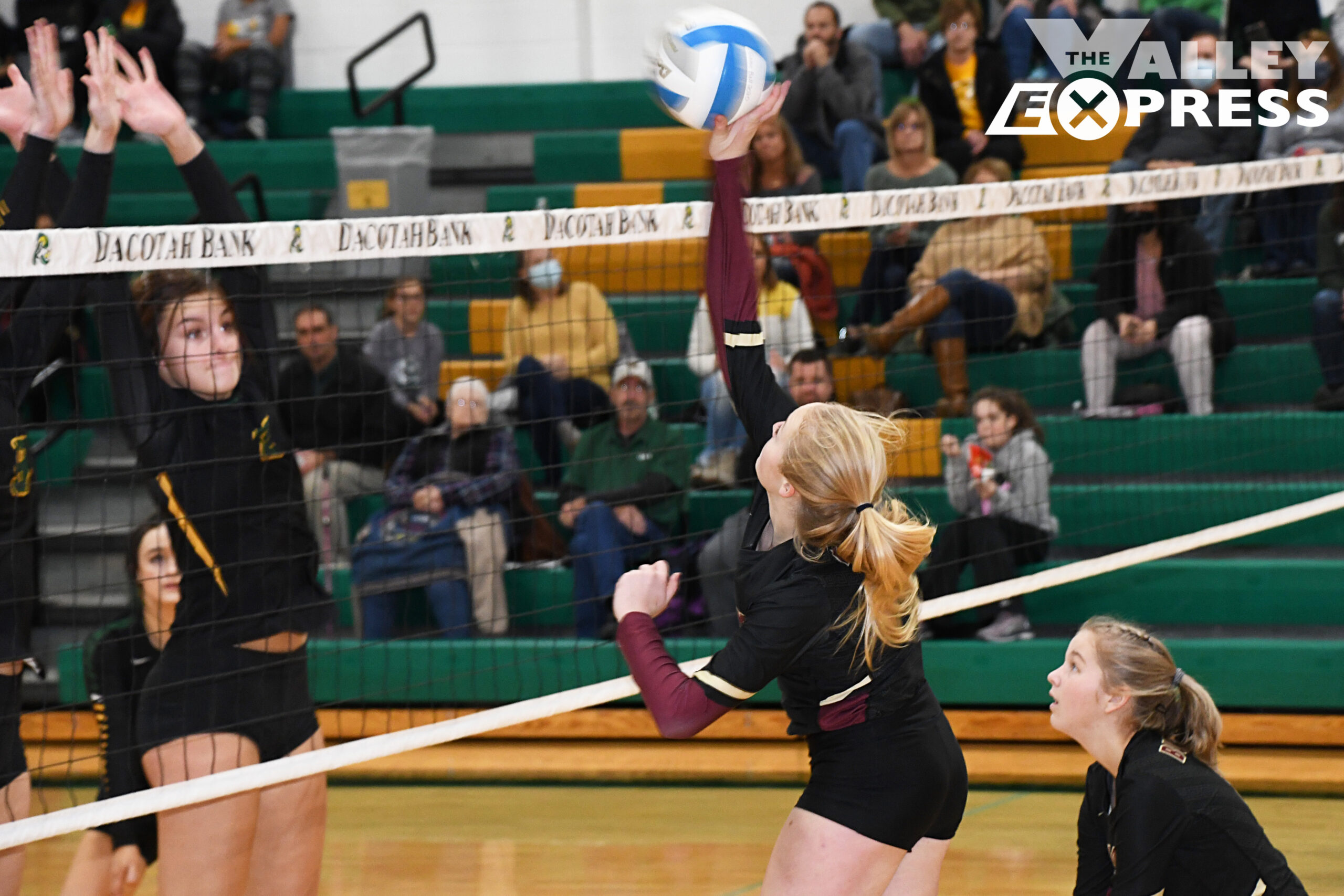 Milbank Takes TZ to Four Sets; Falls to Top Roncalli Team